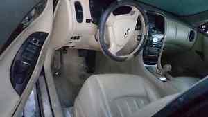 Infiniti G35 Coupe Interior repair Montreal infiniti repair montreal